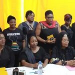 Women announce a black Women's day.